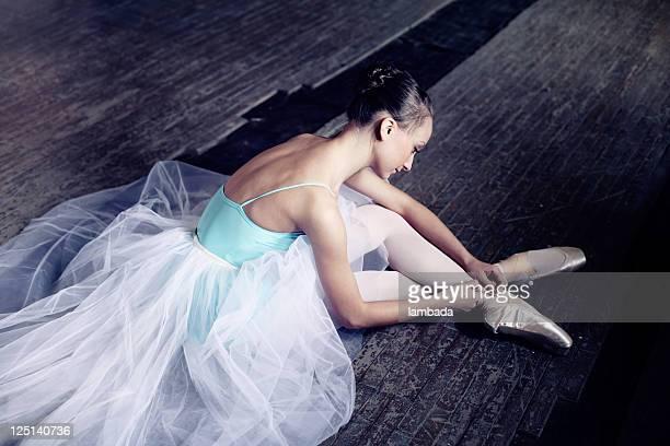 Ballerina putting on pointes