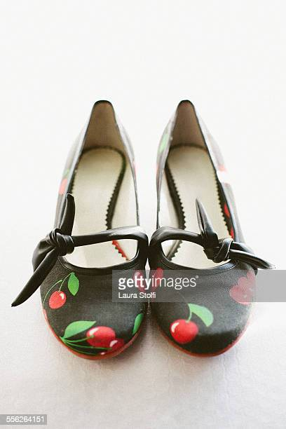 Ballerina shoes with red cherries on them