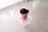 Ballerina spinning on floor, blurred motion