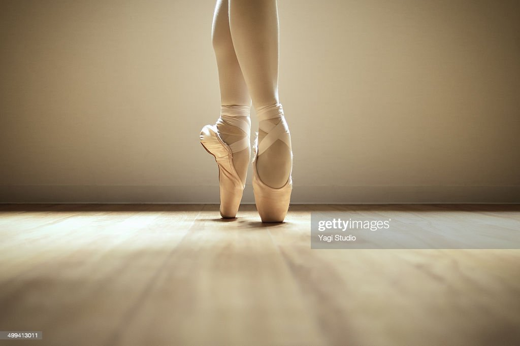 Ballerina standing on toes : Stock Photo
