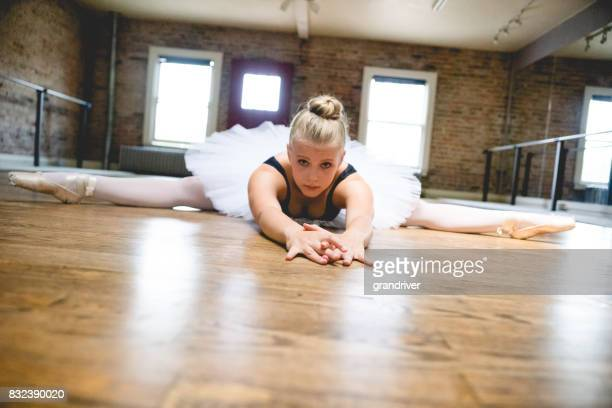 Ballerina Stretching on the Floor