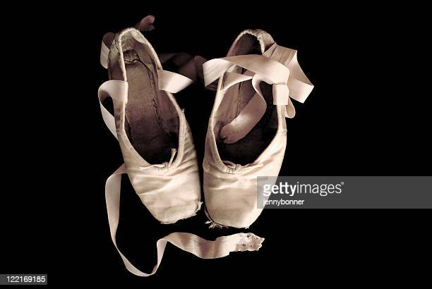 Ballerina: Worn Out Ballet Pointe Shoes Black Background