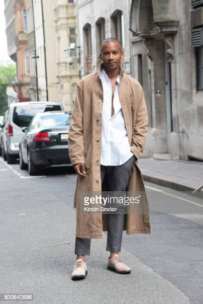 Ballet dancer and model Eric Underwood wears Kurt Geiger shoes with an Insomnia shirt jjacket and trousers on day 1 of London Collections Men on June...
