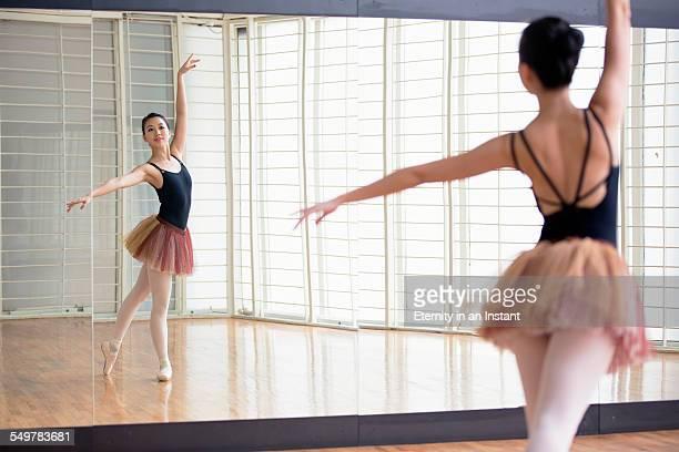 Ballet dancer dancing in front of mirror