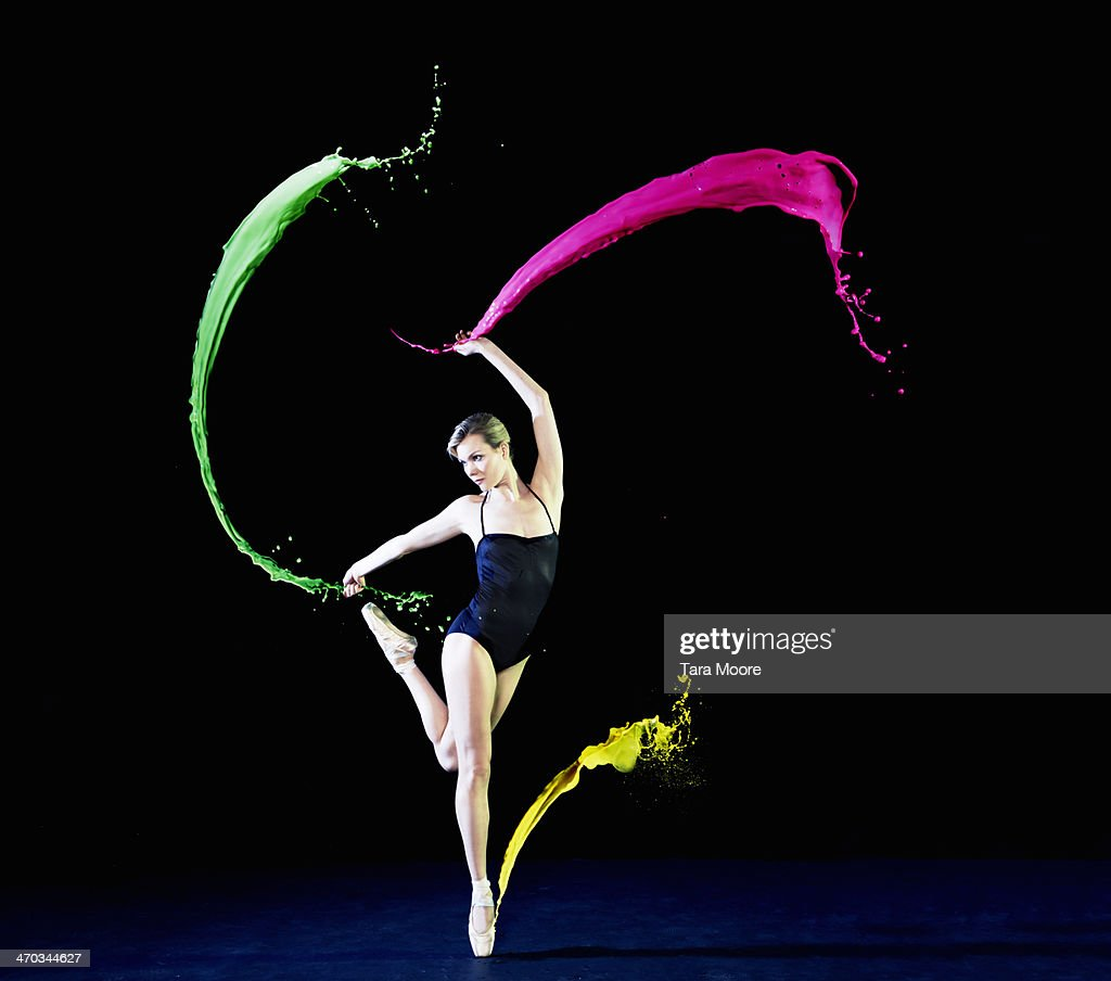 ballet dancer dancing with paint splashes