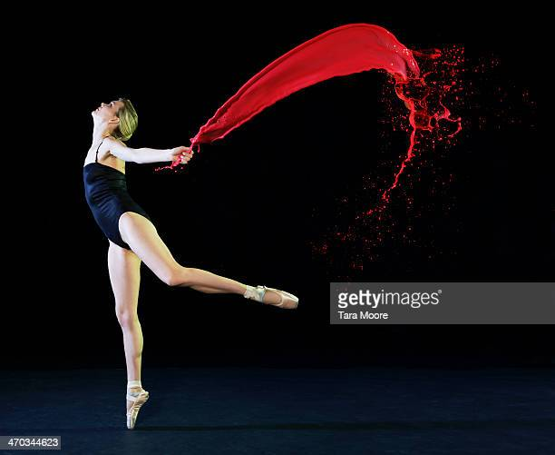 ballet dancer dancing with red paint splashes