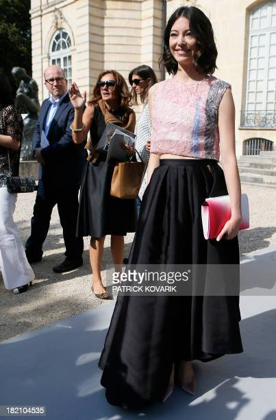 Ballet dancer Hannah O'Neill poses during a photocall prior to Christian Dior 2014 Spring/Summer readytowear collection fashion show on September 27...