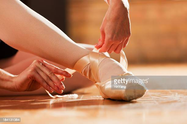 Ballet Dancer in Dance Studio, Foot with Ballet Slippers Shoes
