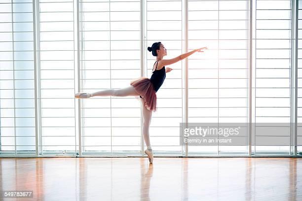 Ballet dancer in studio dancing