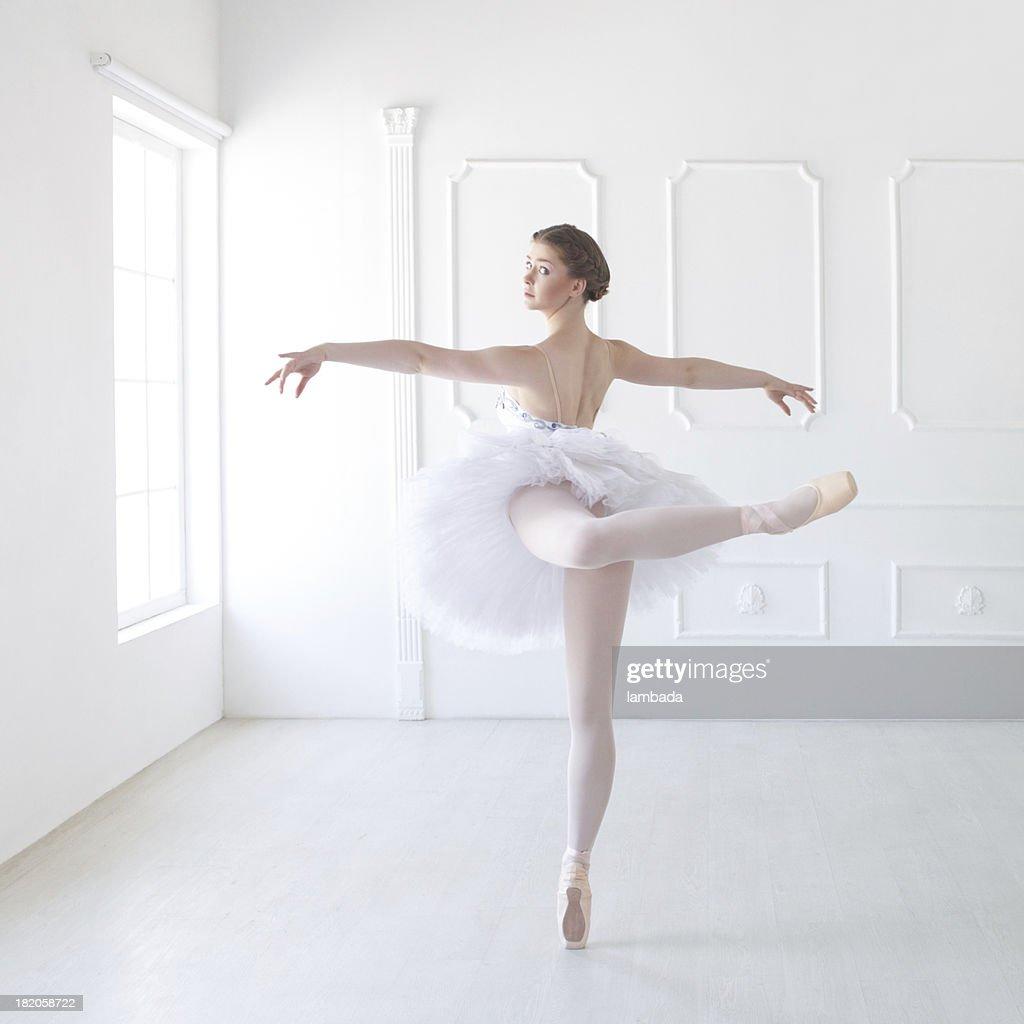 Ballet dancer in white studio