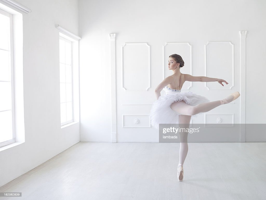 Ballet dancer in white studio : Stock Photo