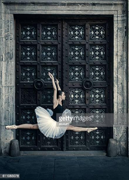 Ballet dancer jumping in the street
