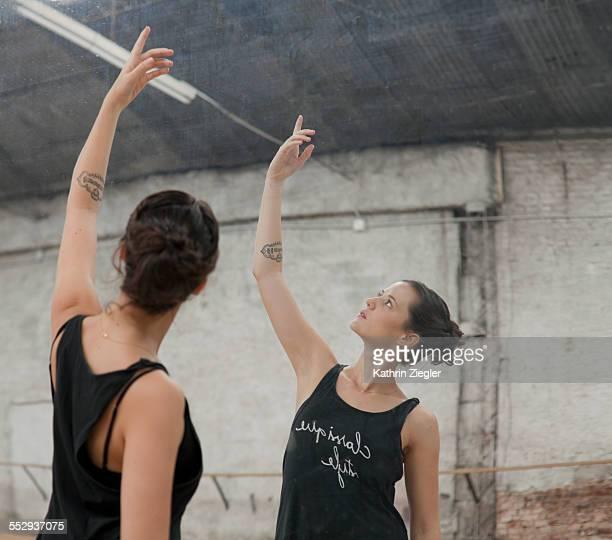 ballet dancer practicing in front of mirror