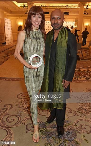 Ballet dancer Sylvie Guillem winner of the Outstanding Achievement award and presenter Akram Khan attend the South Bank Sky Arts awards at The Savoy...