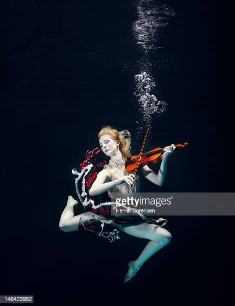 ballet dancer underwater with violin