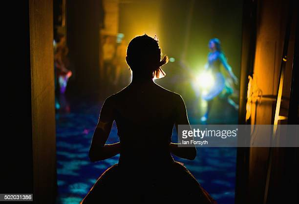 A ballet dancer waits in the wings for her turn to take the stage during a performance of The Nutcracker by Northern Ballet at the Grand Theatre on...