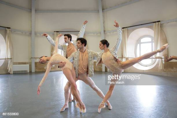 Ballet dancers Amandine Albisson Audric Bezard Mathias Heynemann and Hannah O'Neill wearing Olivier Rousteing designed costumes are photographed for...