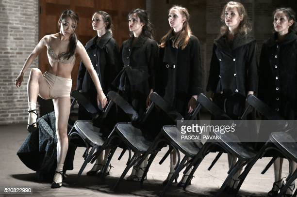 Ballet dancers of the Capitole de Toulouse are seen on stage on April 13 2016 in the Auditorium SaintPierre des Cuisines in Toulouse as they perform...