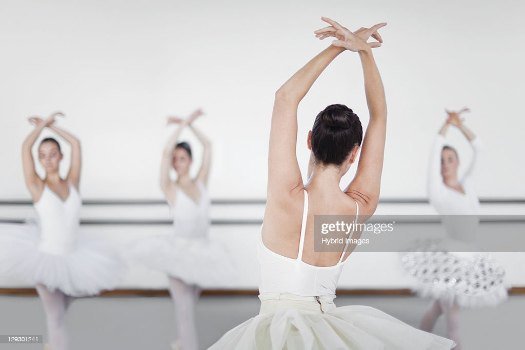 Ballet dancers posing in studio : Stock Photo
