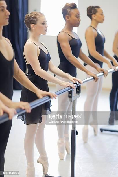 Ballet dancers practicing at barre
