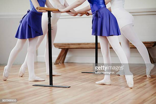 Ballet dancers practising poses in dance studio