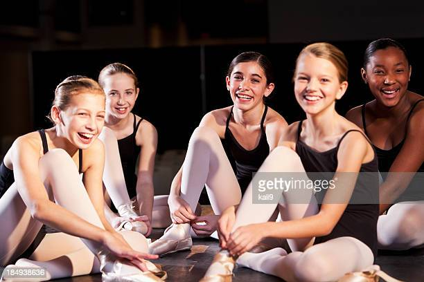 Ballet dancers putting on slippers