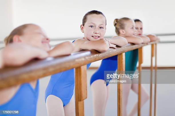 Ballet dancers standing at barre