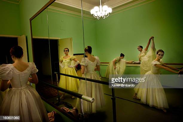 Ballet dancers warm up on April 10 2011 in the Bolshoi Ballet Theatre in Moscow Russia