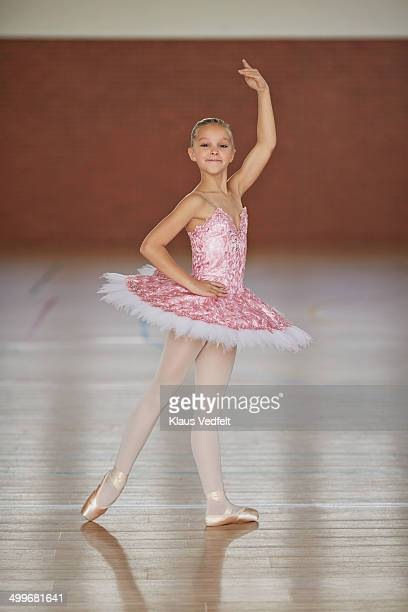 Ballet girl posing with arm up