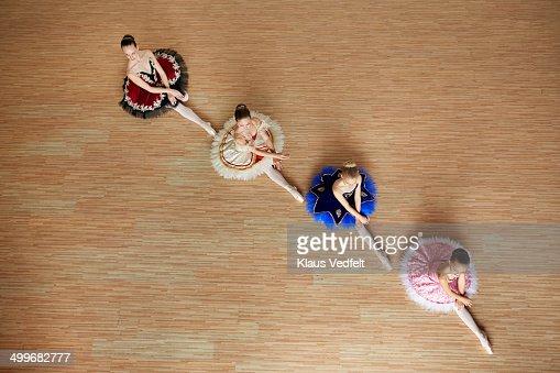 Ballet girls posing sitting, top view
