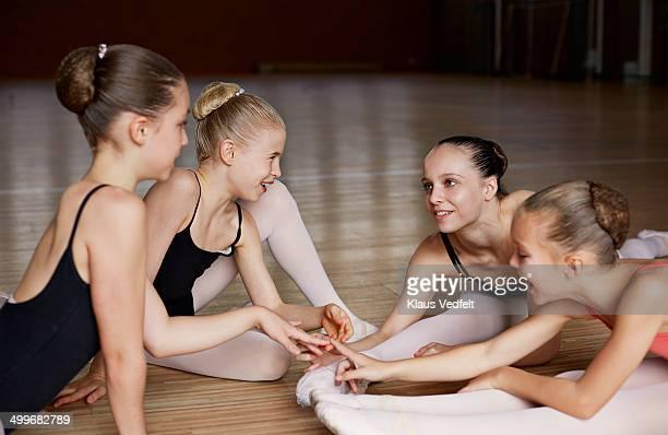 Ballet girls streching & talking after training