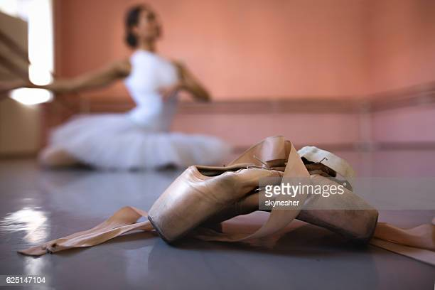 Ballet pumps with ballerina in the background.