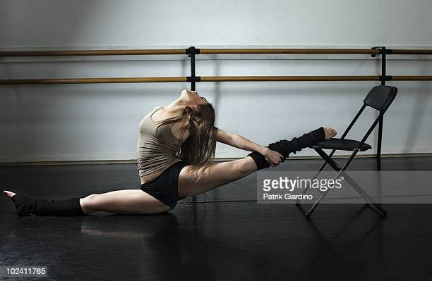 Ballet stretching in dance studio