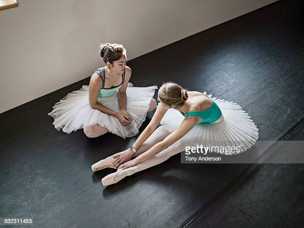 Ballet students relaxing backstage