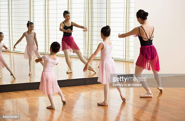 Ballet teaching young ballerinas