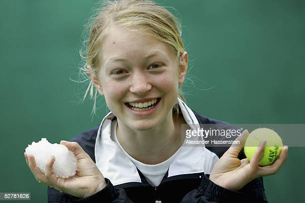 Ballgirl Gianna Kuehn holds a snowball after a thunderstorm during the Masters Series Hamburg at Rothenbaum on May 10 2005 in Hamburg Germany