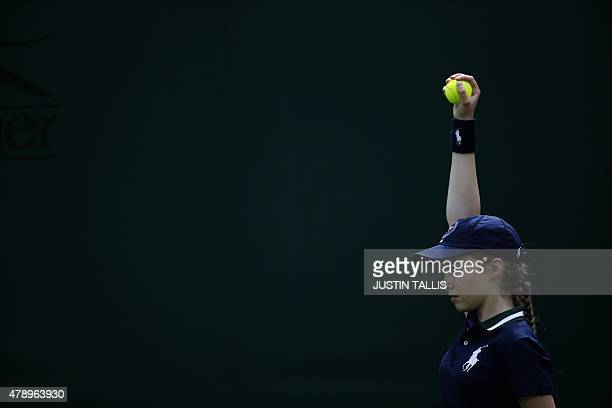 A ballgirl offers a ball during the men's singles first round match between Australia's Thanasi Kokkinakis and Argentina's Leonardo Mayer on day one...