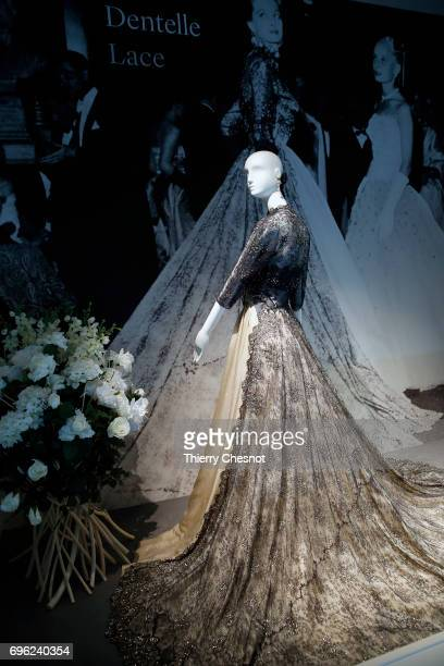 Ballgown in Chantilly lace and satin and matching bolero In the photograph the model and a actrice Capucine wears thee grown at a ball given at...