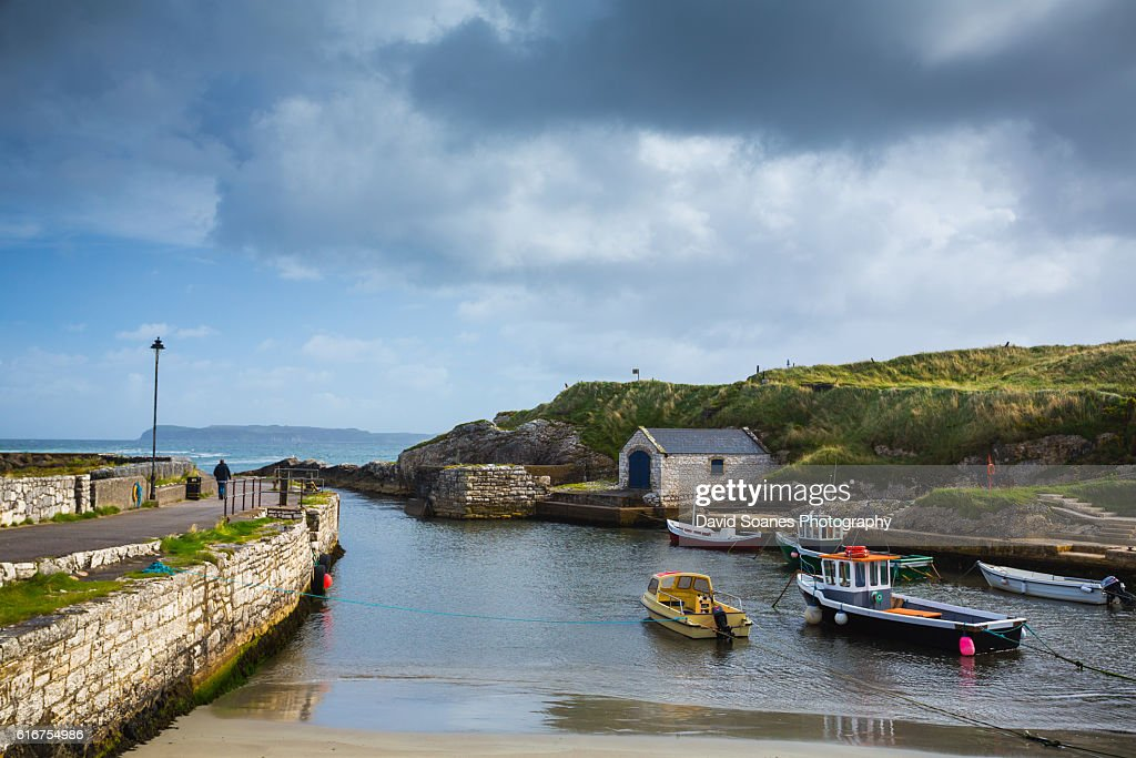 Ballintoy harbour along the Causeway Coast in Antrim, Northern Ireland : Stock Photo