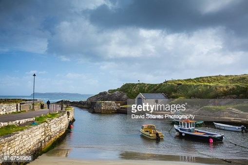 Ballintoy harbour along the Causeway Coast in Antrim, Northern Ireland : Stock Photo
