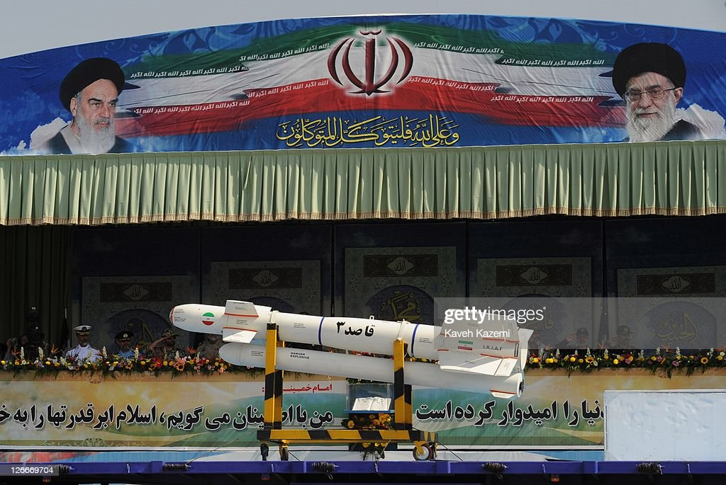 A ballistic missile is paraded past a podium from which Major General Hassan Firoozabadi and other military commanders observe a parade commemorating the 31st anniversary of Iran-Iraq war on September 22, 2011 in Tehran, Iran. Iran is holding military parades in Tehran and other parts of the country on the first day of the Sacred Defence Week. Tehran's parade began to the north of Imam Khomeini's mausoleum providing the army, Islamic Revolution Guards Corps, Law Enforcement Force and Basij with an opportunity to display their state of military preparedness, in which armaments and indigenously built military equipment including Shahab missiles, unmanned aircrafts, Zulfaqar tanks, and a variety of rapid fire machine guns were showcased.