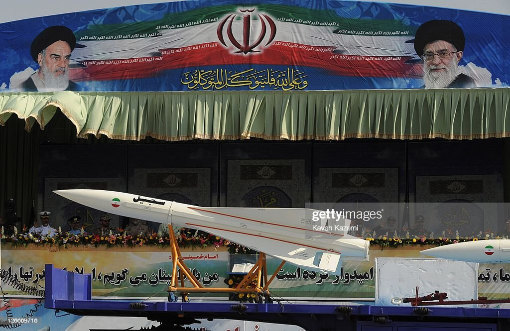Ballistic missiles are paraded past a podium from which Major General Hassan Firoozabadi and other military commanders observe a parade commemorating the 31st anniversary of Iran-Iraq war on September 22, 2011 in Tehran, Iran. Iran is holding military parades in Tehran and other parts of the country on the first day of the Sacred Defence Week. Tehran's parade began to the north of Imam Khomeini's mausoleum providing the army, Islamic Revolution Guards Corps, Law Enforcement Force and Basij with an opportunity to display their state of military preparedness, in which armaments and indigenously built military equipment including Shahab missiles, unmanned aircrafts, Zulfaqar tanks, and a variety of rapid fire machine guns were showcased.