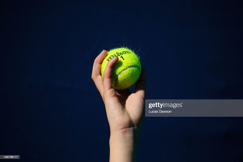 A ballkid displays a tennis ball during day six of the 2013 Australian Open at Melbourne Park on January 19, 2013 in Melbourne, Australia.