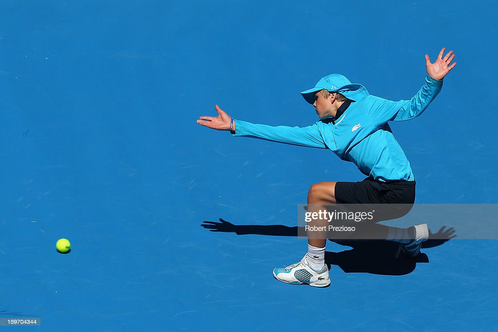 A ballkid throws a tennis ball in the third round match between Jeremy Chardy of France and Juan Martin Del Potro of Argentina during day six of the 2013 Australian Open at Melbourne Park on January 19, 2013 in Melbourne, Australia.