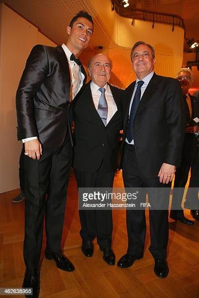Ballon d'Or nominee Cristiano Ronaldo of Portugal and Real Madrid poses with FIFA President Joseph S Blatter and Real Madrid president Florentino...