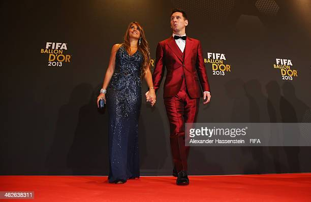 Ballon d'Or nominee Lionel Messi of Argentina and Barcelona and Antonella Roccuzzo arrive during the FIFA Ballon d'Or Gala 2013 at the Kongresshaus...