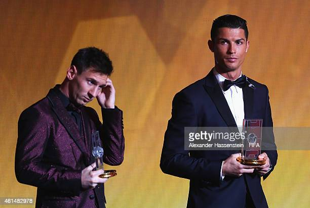 Ballon d'Or nominee Lionel Messi of Argentina and Barcelona stands with fellow nominee Cristiano Ronaldo of Portugal and Real Madrid as they are...