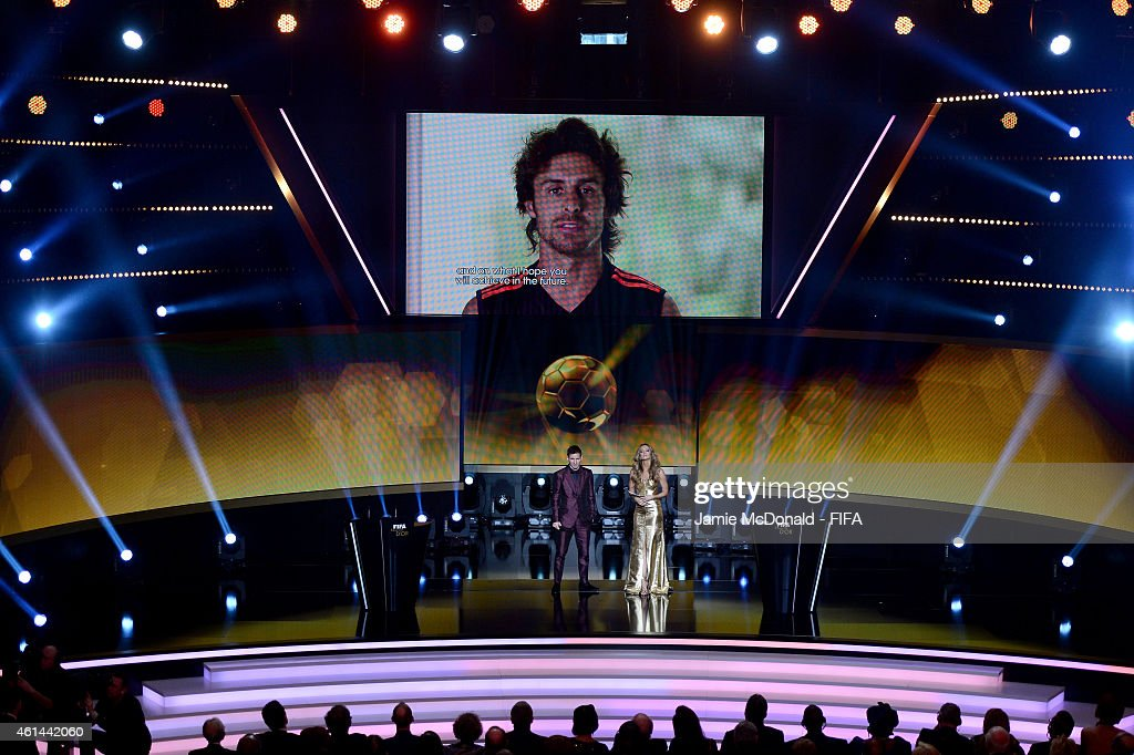 Ballon d'Or nominee <a gi-track='captionPersonalityLinkClicked' href=/galleries/search?phrase=Lionel+Messi&family=editorial&specificpeople=453305 ng-click='$event.stopPropagation()'>Lionel Messi</a> of Argentina and Barcelona watches a message from <a gi-track='captionPersonalityLinkClicked' href=/galleries/search?phrase=Pablo+Aimar&family=editorial&specificpeople=216627 ng-click='$event.stopPropagation()'>Pablo Aimar</a> on the big screen during the FIFA Ballon d'Or Gala 2014 at the Kongresshaus on January 12, 2015 in Zurich, Switzerland.