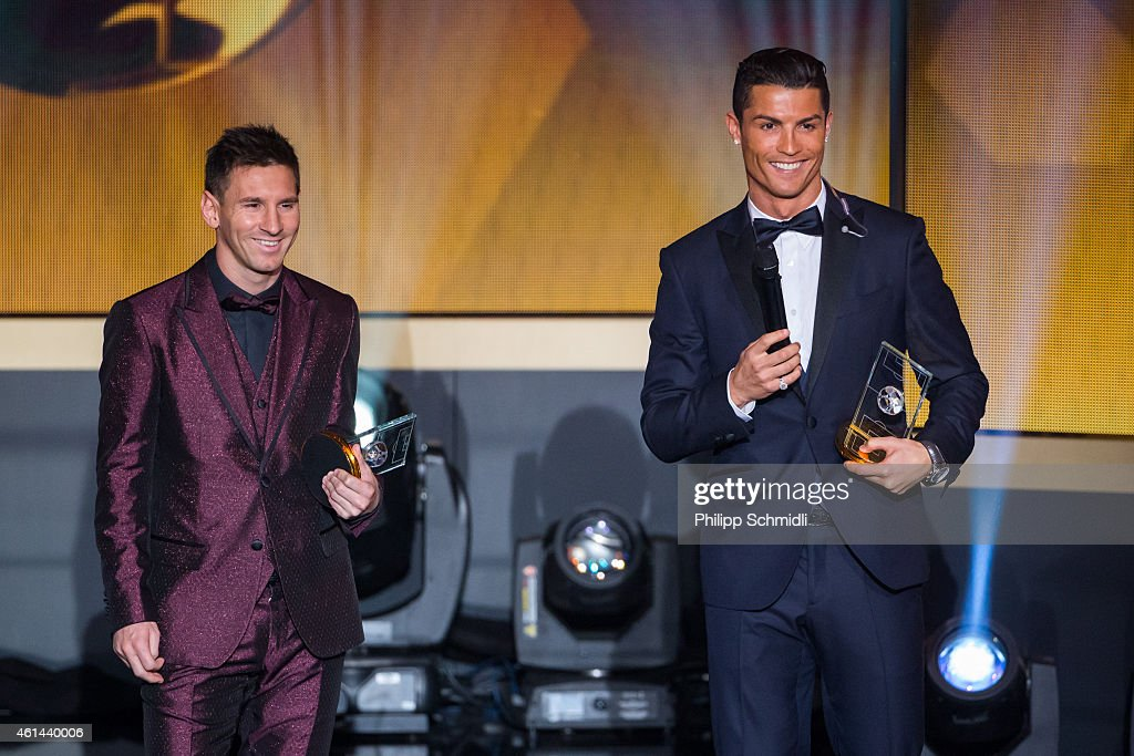 Ballon d'Or nominees Lionel Messi of Argentina and FC Barcelona (L) and Cristiano Ronaldo of Portugal and Real Madrid smile during the FIFA Ballon d'Or Gala 2014 at the Kongresshaus on January 12, 2015 in Zurich, Switzerland.