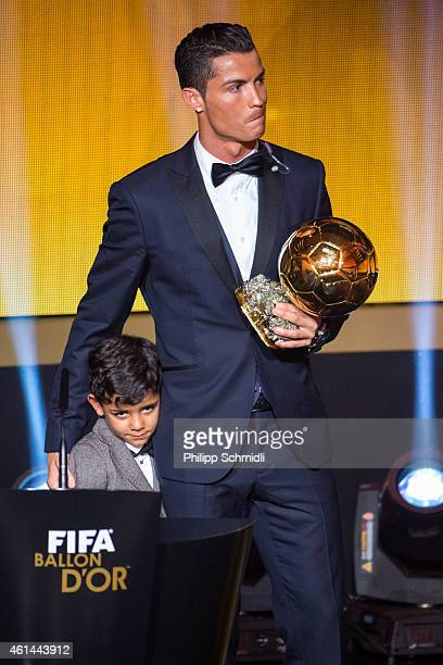 Ballon d'Or winner Cristiano Ronaldo of Portugal and Real Madrid and his son Cristiano Ronaldo junior stand on the stage after the FIFA Ballon d'Or...